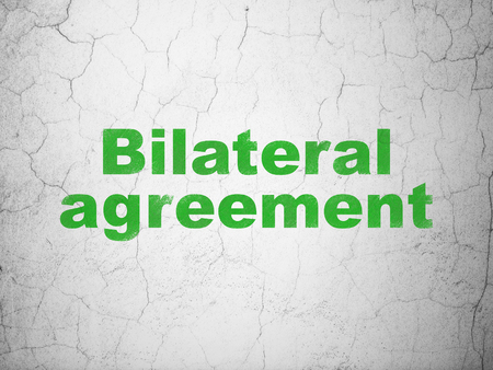 Insurance concept: Green Bilateral Agreement on textured concrete wall background Stock Photo