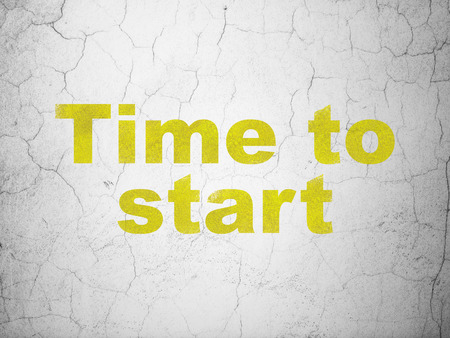 Time concept: Yellow Time to Start on textured concrete wall background