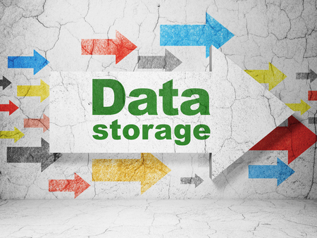 Information concept:  arrow with Data Storage on grunge textured concrete wall background, 3D rendering