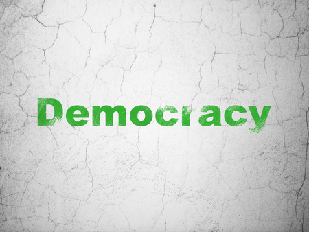 Political concept: Green Democracy on textured concrete wall background