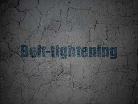 Business concept: Blue Belt-tightening on grunge textured concrete wall background Stock Photo