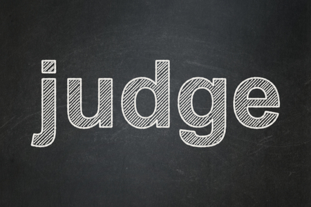 Law concept: text Judge on Black chalkboard background