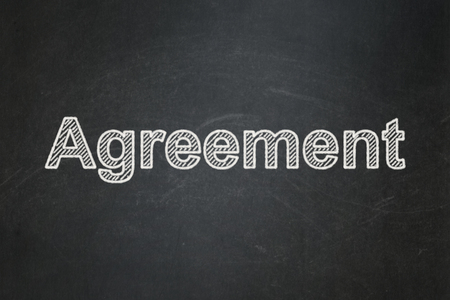Business concept: text Agreement on Black chalkboard background