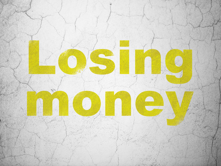 Banking concept: Yellow Losing Money on textured concrete wall background Stock Photo