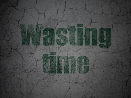 Time concept: Green Wasting Time on grunge textured concrete wall background Stock Photo