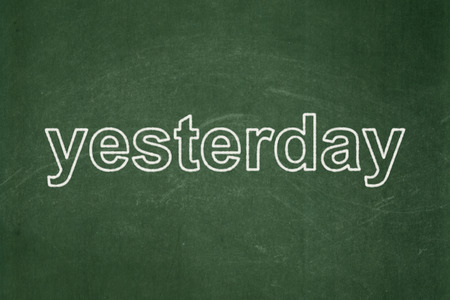 Time concept: text Yesterday on Green chalkboard background
