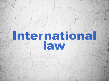 Political concept: Blue International Law on textured concrete wall background