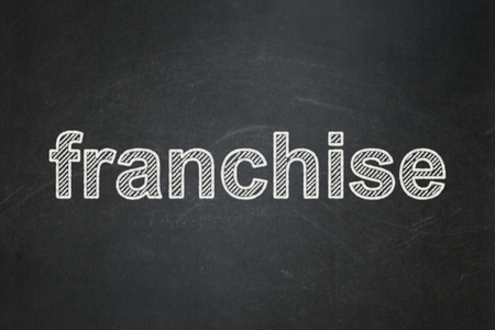 Business concept: text Franchise on Black chalkboard background