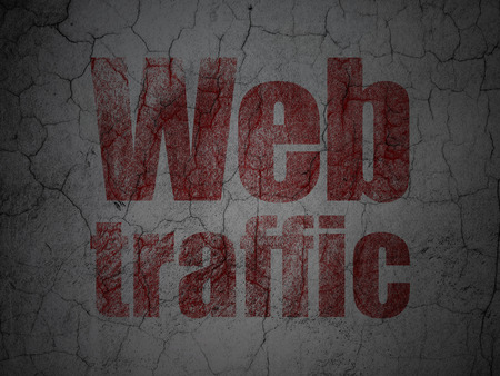 Web development concept: Red Web Traffic on grunge textured concrete wall background