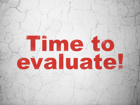 Timeline concept: Red Time to Evaluate! on textured concrete wall background