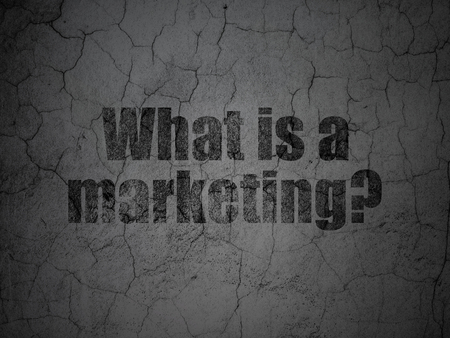 Advertising concept: Black What is a Marketing? on grunge textured concrete wall background