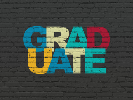 Learning concept: Painted multicolor text Graduate on Black Brick wall background Banco de Imagens