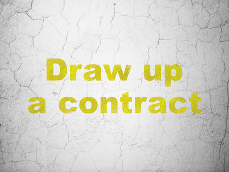 Law concept: Yellow Draw up A contract on textured concrete wall background Stock Photo