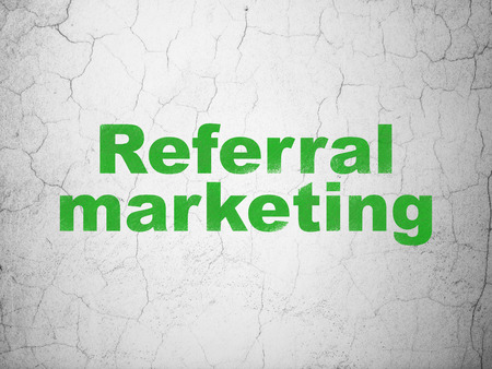 Advertising concept: Green Referral Marketing on textured concrete wall background Stock Photo