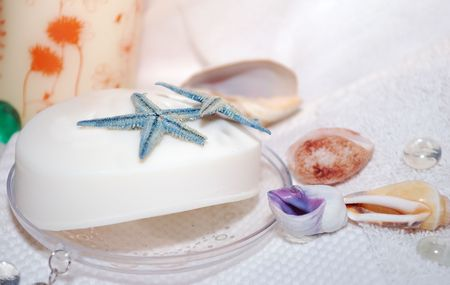 White soap with two blue seastars location on the towel.  Stock Photo - 4144602