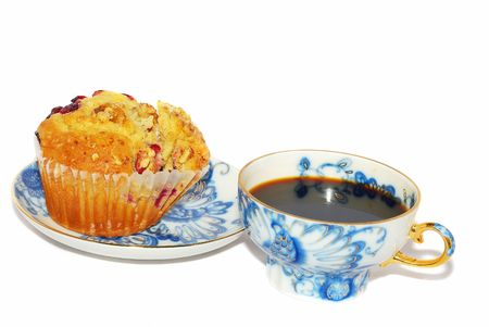 Luxor blue coffee cup with cranberry muffin  isolated on the white. photo