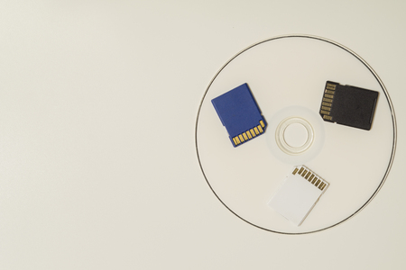 Memory card and digital disc isolated on white background. sd card and cd macro. copy space