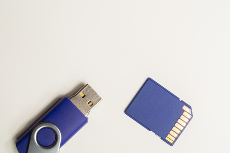 Memory card and memory stick isolated on white background. usb flash drive. sd card macro. copy space Imagens
