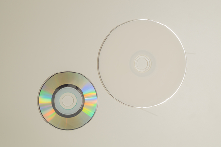 Compact discs on a white background. copy space