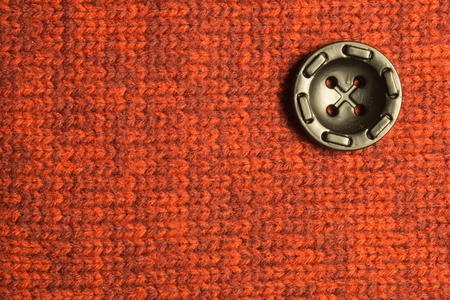 Button on textile background. copy space