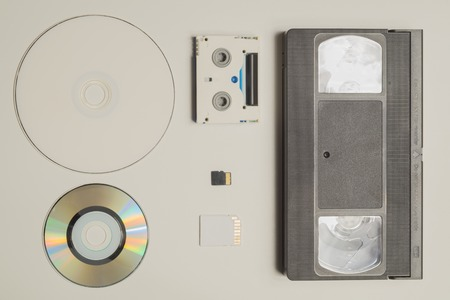 Various media types. compact disc. memory card. video tape. digital video cassette. media types evolution Stock Photo
