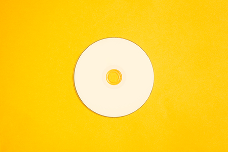 Compact disc on a yellow background. copy space Stock Photo
