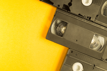 Video cassette isolated on yellow background. vhs with copy space