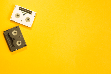 Digital video cassette on yellow background. mini cassette. copy space Stock Photo