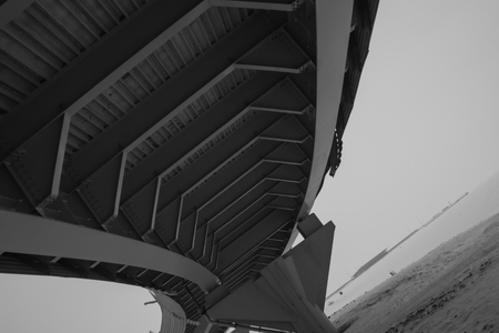 Architecture lines under the bridge. Speedway black and white