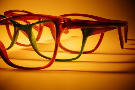 Rimmed eyeglasses closeup on a white background abstract view Фото со стока - 120787943