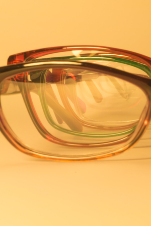 Rimmed eyeglasses closeup on a white background abstract view Stock Photo