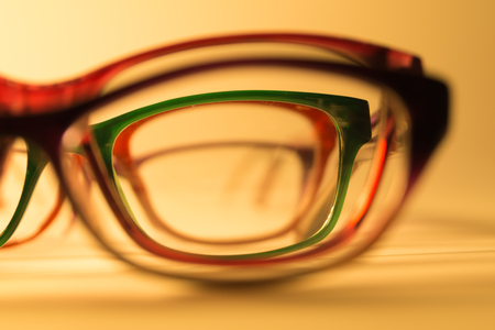 Rimmed eyeglasses closeup on a white background abstract view Imagens