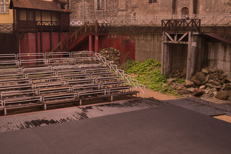 Empty benches on tribune with scene background