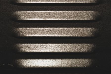 Gray metal background. detail of case apparatus. steel panel