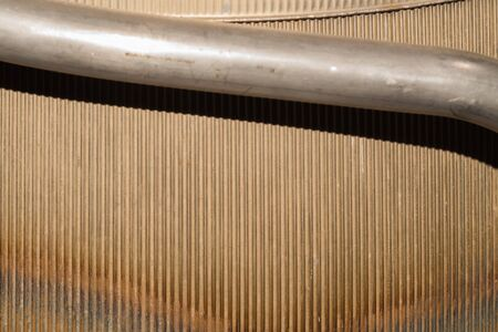 Old ribbed metal texture. corrugated steel background. metal pipe
