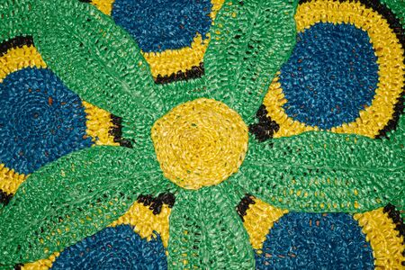 Rug from recycled material. recycled textiles used to make colorful rugs. reuse concept