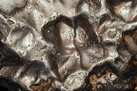 Fondo de textura de meteorito. superficie de meteorito de cerca. telón de fondo de piedra