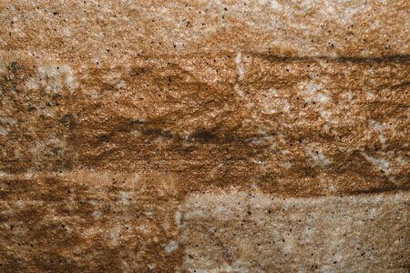 Stone texture background close up. brown stone with cracks on the surface
