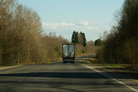 Car driving on a highway. auto moving on a roadway background 写真素材