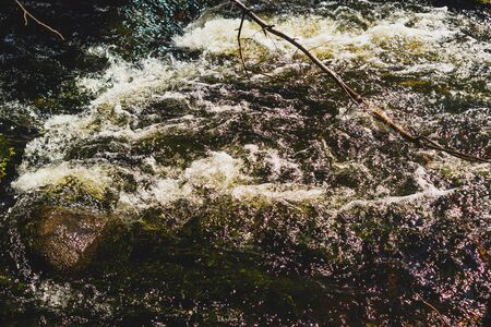 Water stream with foam. falling river water. waterfall flow. water background