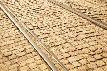 Brick texture. tram rails on stone pavement background