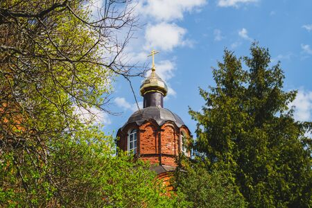 Beautiful old church tower with the cross on the hill. church in the forest Stock Photo