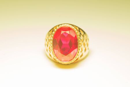 Golden ring with ruby isolated on white background