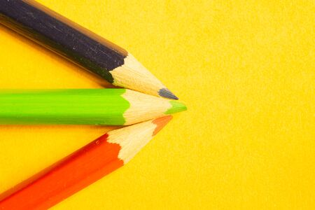 Colorful pencils isolated on yellow background. drawing supplies Zdjęcie Seryjne - 129828045