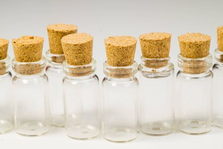 Empty little bottles with cork stopper isolated on white. glass vessels. transparent containers. test tubes