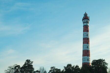 Lighthouse in the forest. red and white lighthouse background