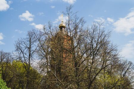 Beautiful old church tower with the cross on the hill. church in the forest Reklamní fotografie