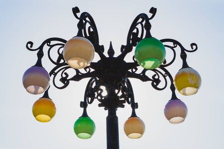 Vintage colorful street lamp against the sky. Retro lantern
