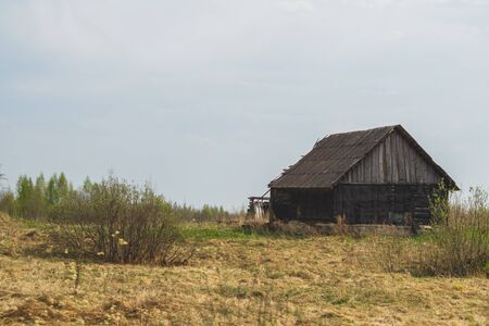 Old wooden house on the countryside. house standing alone among the field