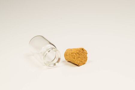 Empty little bottle with cork stopper isolated on white. glass vessel. transparent container. test tube. copy space